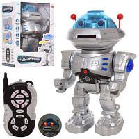 Робот 9894 р/у,30 см, муз, зв (англ.), світло, ходить,стріляє дисками,на бат,в кор-ке 21,5-32-15,5 см