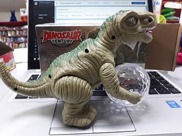 Динозавр пластиковый   музыкальный светящийся с шаром ездит
