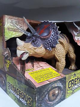 Динозавр заводной светящийся