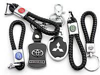 Брелки с логотипами моделей автомобилей.