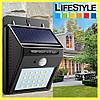 Настенный фонарь на солнечных батареях с датчиком движения светильник - Фото