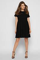 Легкое летнее женское молодежное платье черного цвета.
