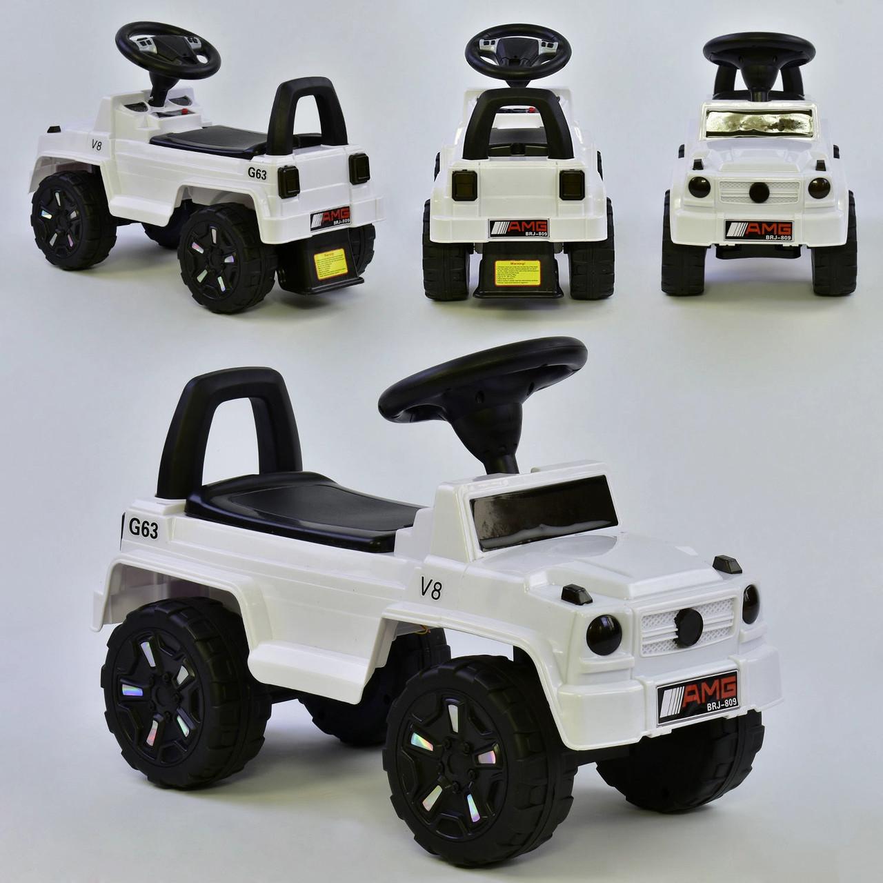 Дитяча машинка-толокар JOY V-10606 Білий (музика, світло, російське звучання, багажник)