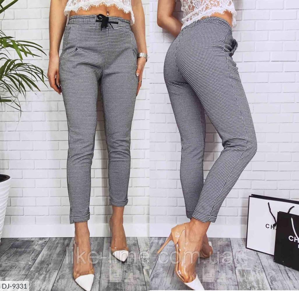 Женские стильные брюки в клетку  с завышенной талией