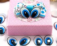 Глазки пластиковые для игрушек овальные 15*11 мм 10 штук голубые без ресничек. Очі для іграшок круглі