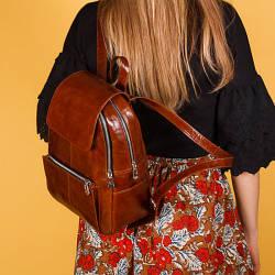 Рюкзак з кишенями,пошиття одягу із натуральної шкіри в будь-якому кольорі.