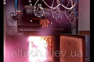 Система эффективного управления промышленным твердотопливным котлом с ручной загрузкой.