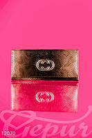 Крупный кошелек украшенный стилизованной эмблемой Gucci