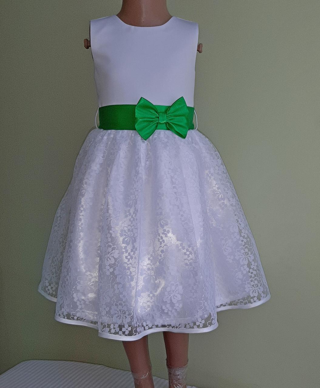 Святкова дитяча білосніжна сукня з зеленим бантом