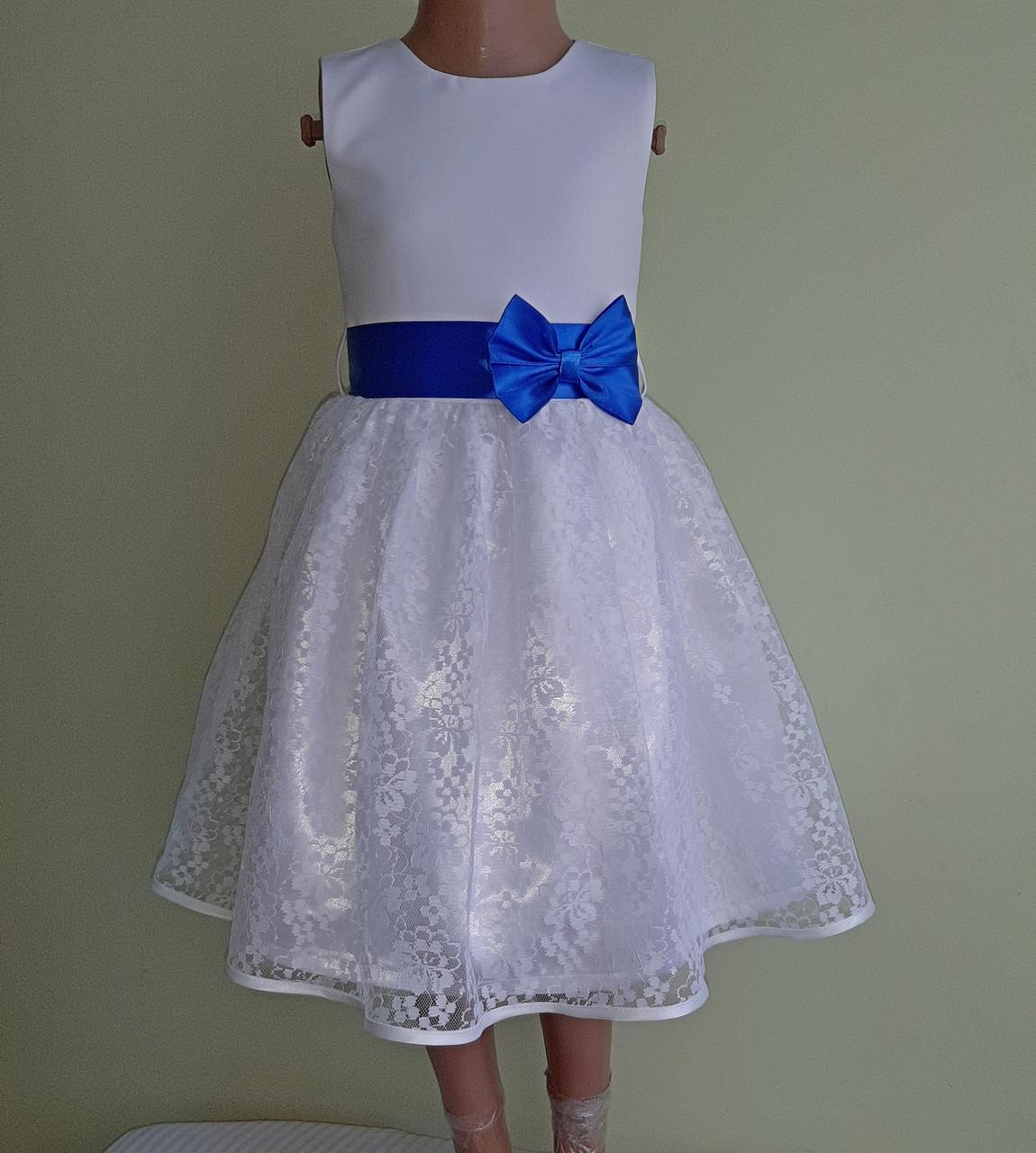 Святкова дитяча білосніжна сукня з синім бантом