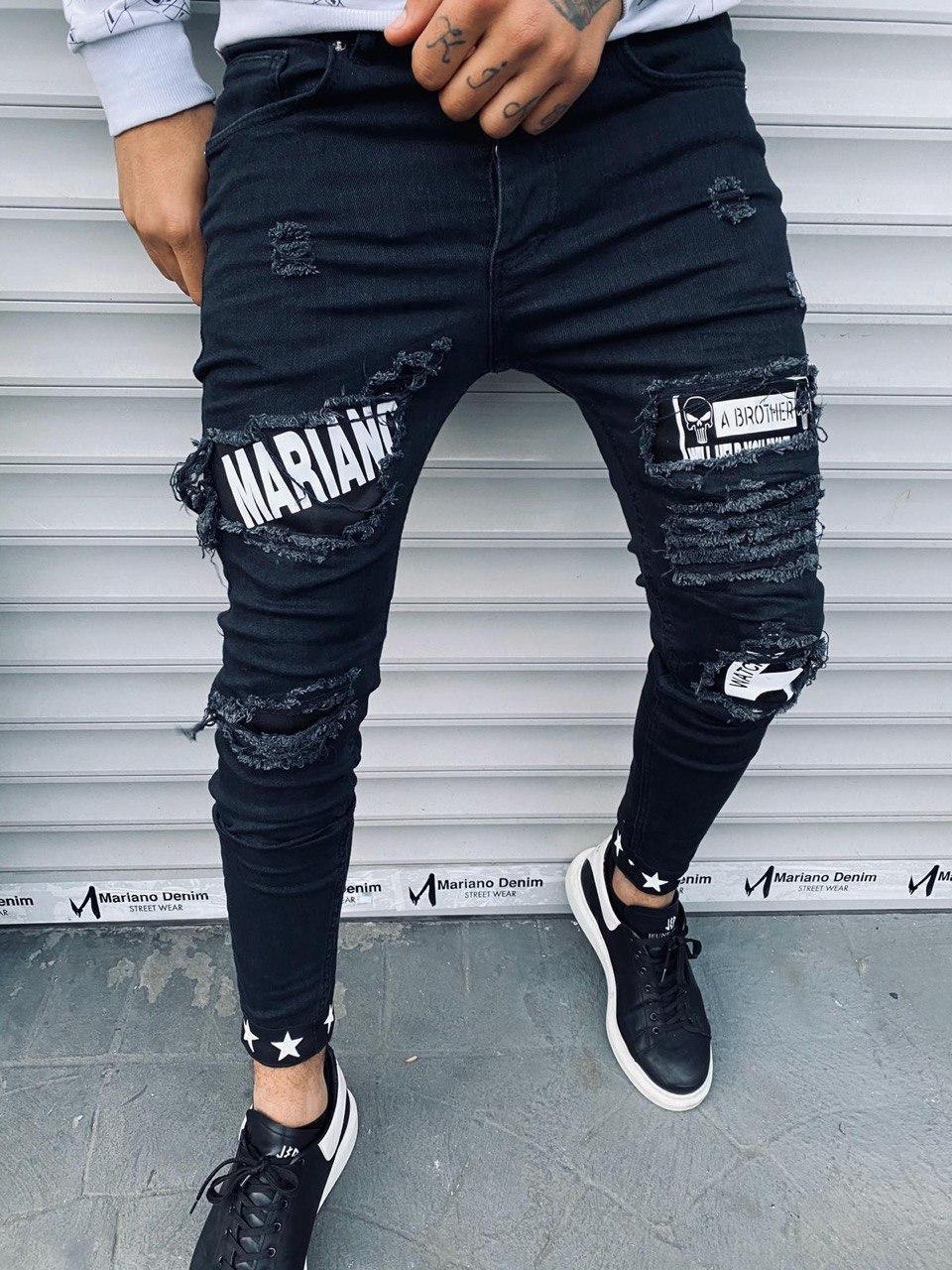 Чоловічі джинси зауженые темно-синього кольору з латками