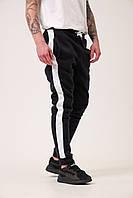 Спортивные штаны с лампасами мужские зимние теплые на флисе черные