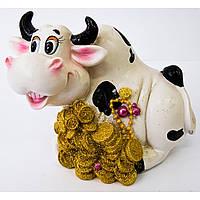 Корова на монетах копилка