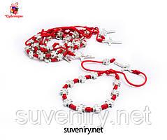 Браслет-оберіг від пристріту з червоної нитки з хрестиками