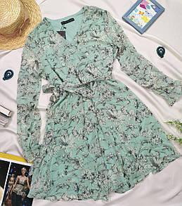 Блакитне жіноче плаття з білим квітковим принтом