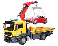 Іграшка евакуатор MAN з навантажувачем і родстером Bruder (03750)