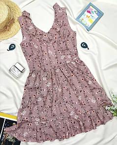 Короткий рожеве жіноче плаття з квітковим принтом