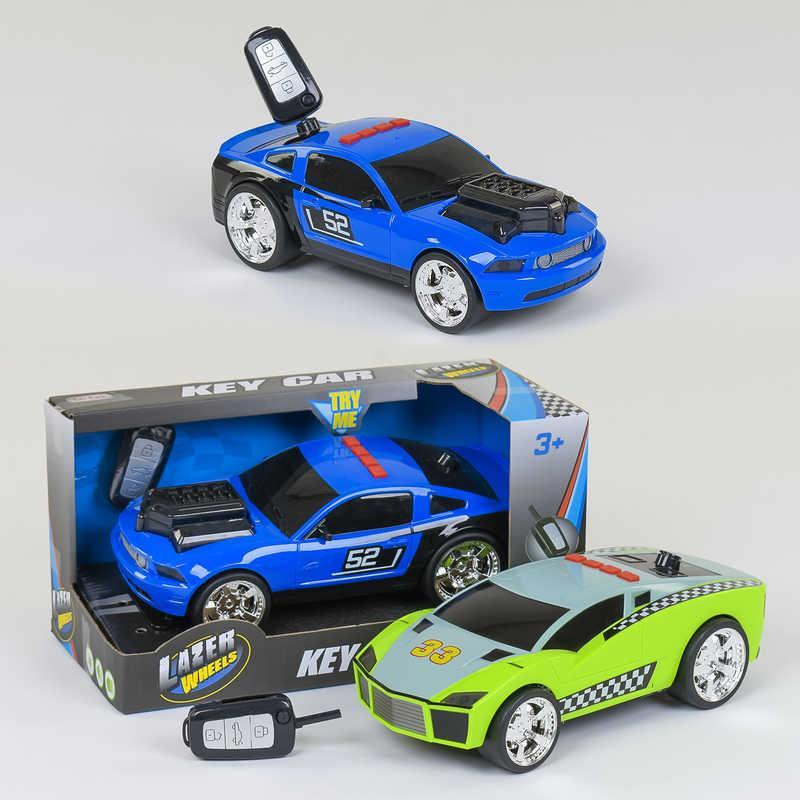 Машина LD 2032 / LD 2033 (12/2) 2 вида, свет, звук, ключ, на батарейках, в коробке