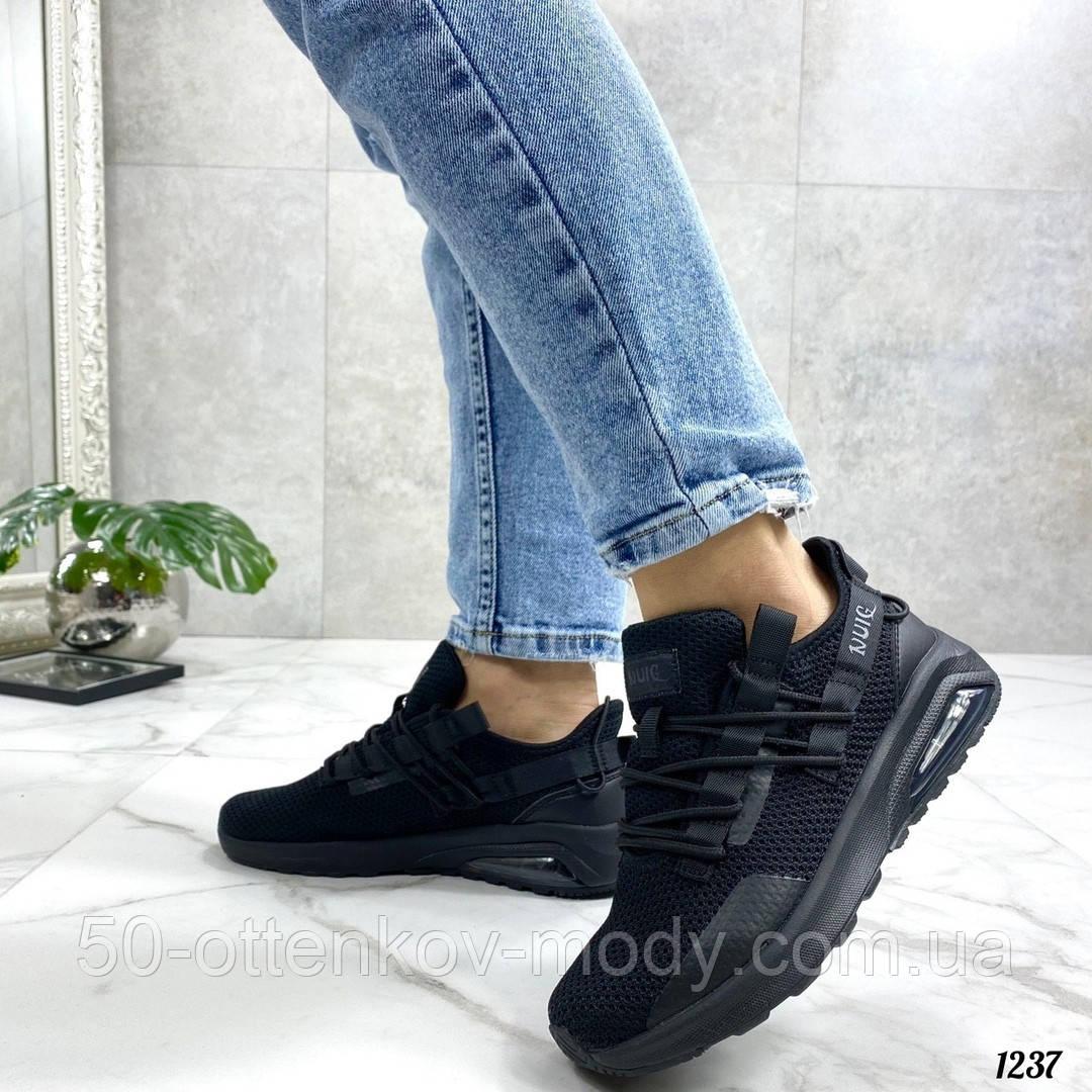 Женские кроссовки Nuig текстильные черные