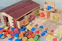 Будинок з геометричними фігурками-вкладками