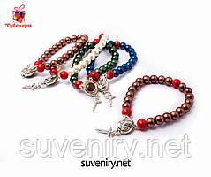 Красивые браслеты на руку с иконкой и святой землей