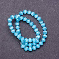Бусины натуральный камень на нитке кошачий глаз Голубой d-8мм L-37см купить оптом в интернет магазине