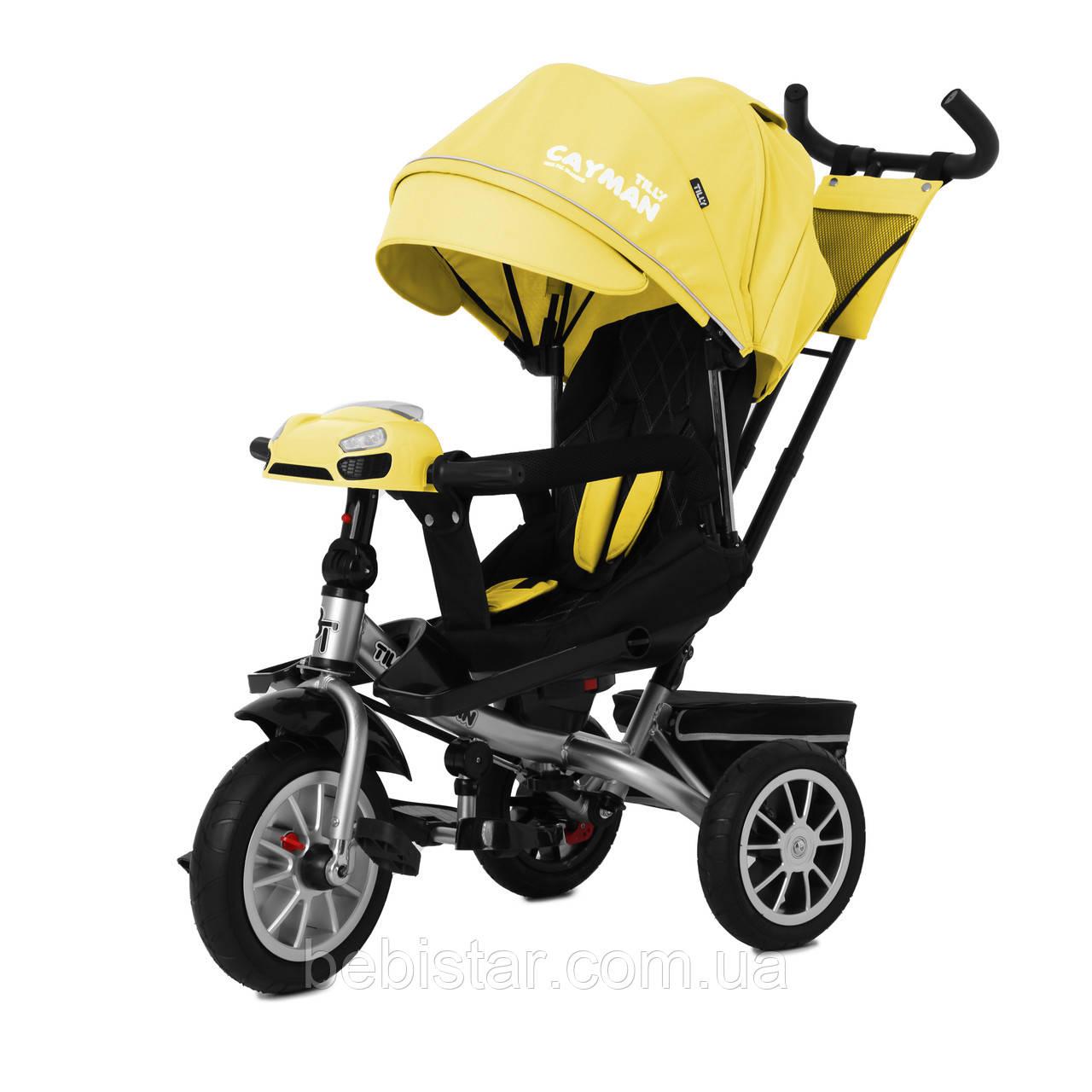 Триколісний велосипед TILLY CAYMAN 381/3 жовтий пульт поворот сидіння надувні коліс музика і світло