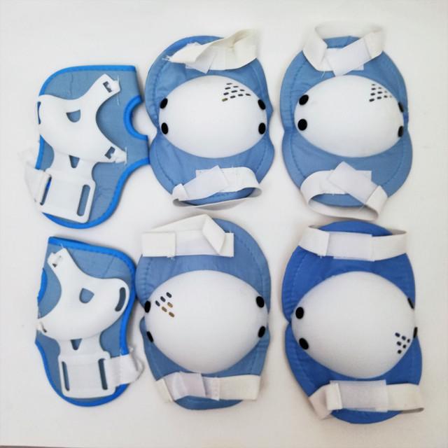 Набір для захисту колін, локтів та долонь при катанні на роликах, скейтбордах MS 0032-1 блакитний з сайту Спорттовари.сом.