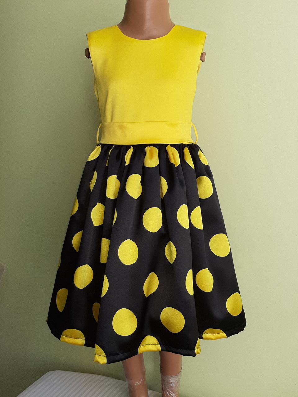 Святкова дитяча жовта сукня з бантом