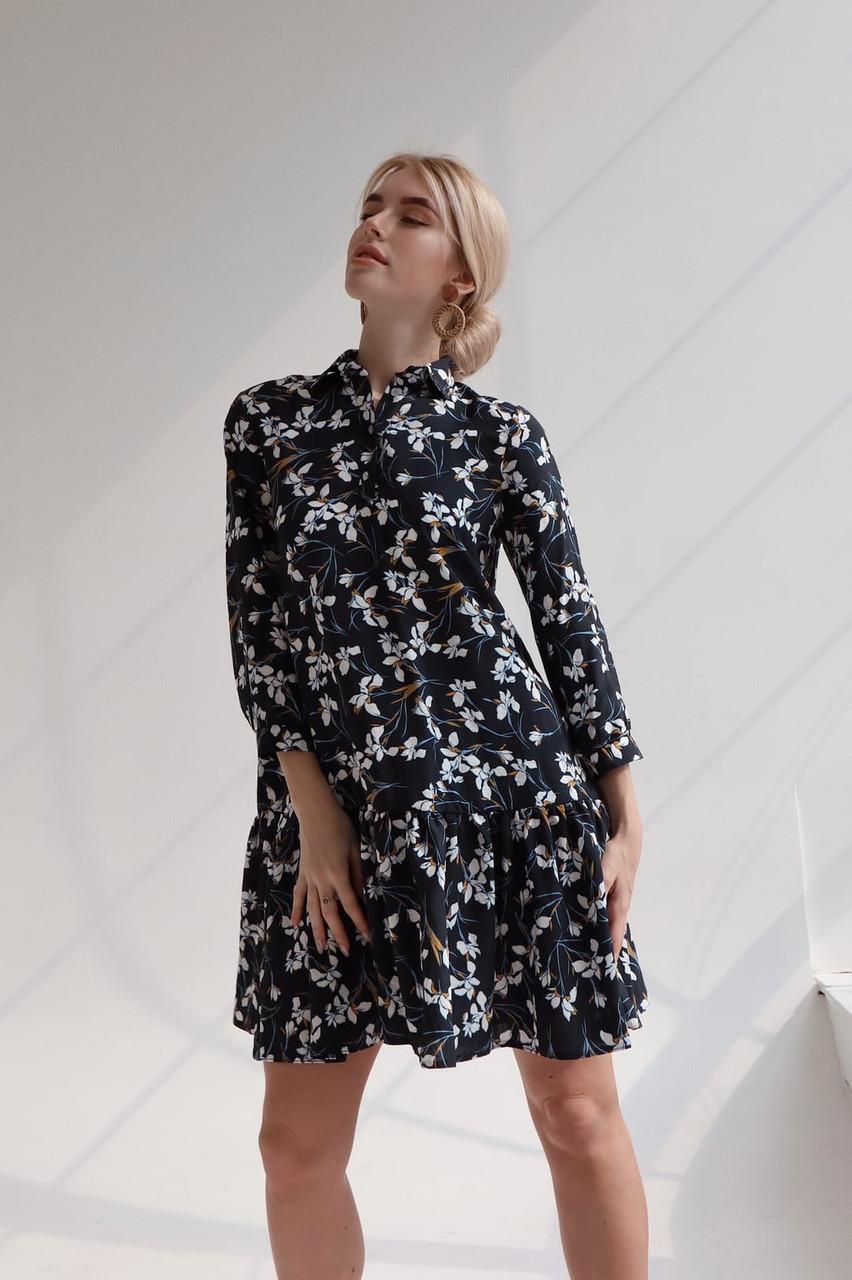 Принтованное платье из штапеля расклешенное с асимметричной оборкой по низу vN7975