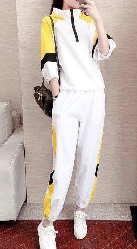 Женский белый спортивный костюм с желтыми вставками vN7995