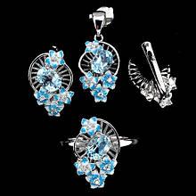 Серебряный комплект с голубыми топазами и эмалью
