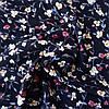Штапель гілочки квітів молочні і рожеві на чорному, ш. 140 см