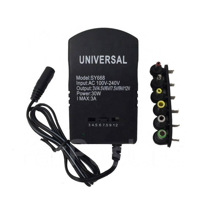 Універсальний зарядний адаптер Run&Teng 668 7в 1 3/4.5/6/7.5/9/12 V 3A
