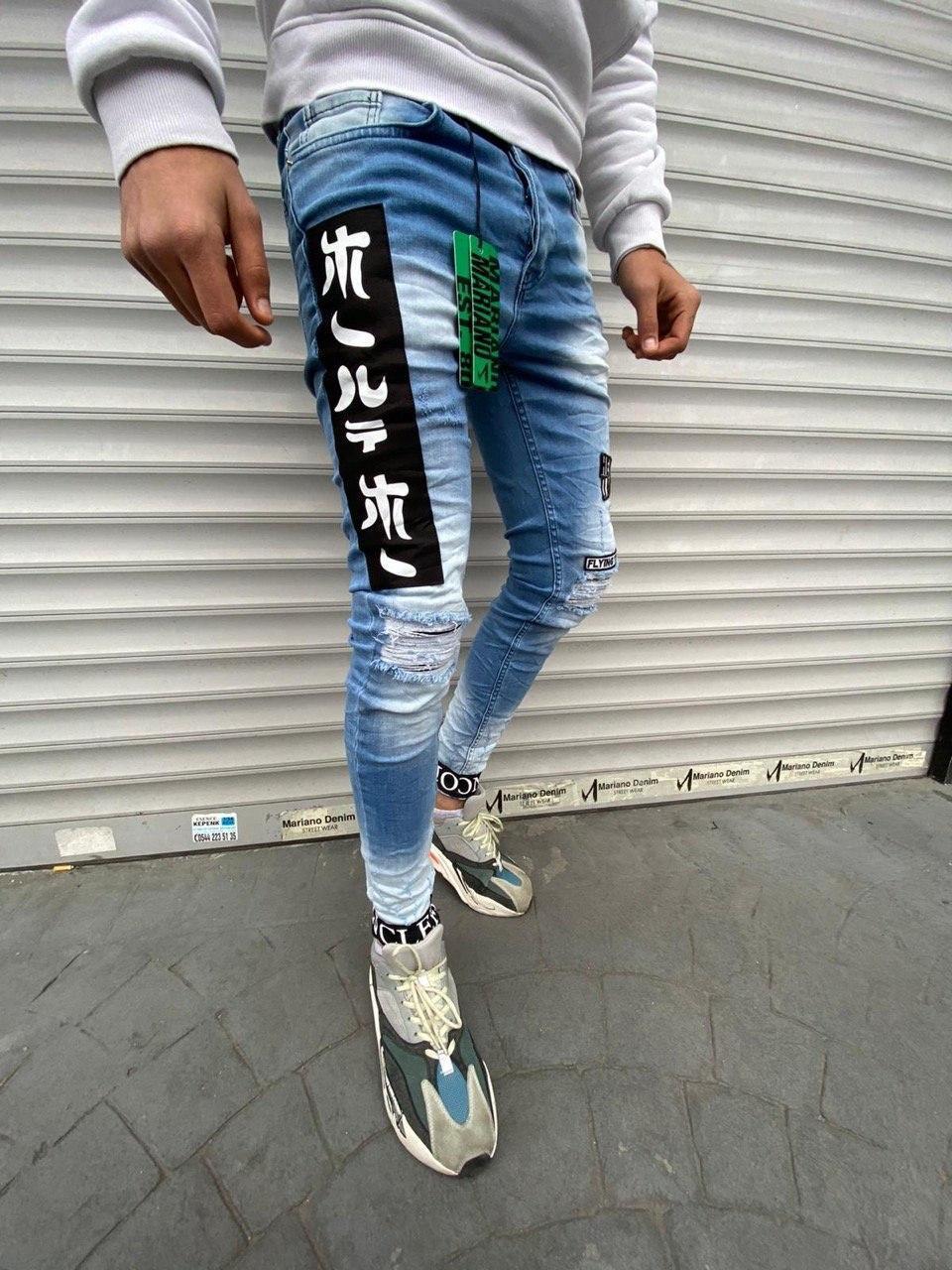 Чоловічі завужені джинси синього кольору з чорними вставками