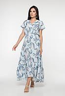 Красивое удлиненное женское платье свободного силуэта