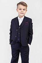 Детский школьный костюм  темно -синего цвета