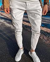 Мужские зауженные молодежные джинсы на весну с дырками на коленях белые 30-34 размер