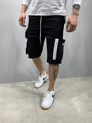 Мужские трикотажные шорты черного цвета с накладными карманами, фото 2