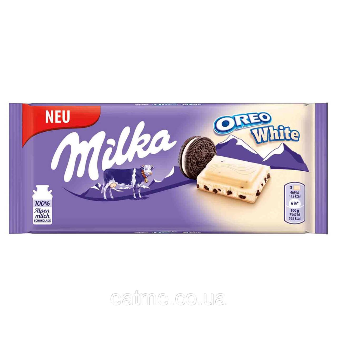 Milka Oreo White Белый шоколад со сливочной начинкой и печеньем Oreo