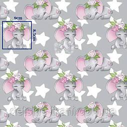 """Х/б тканина """"Слоники з рожевими квітами на голові та зірками"""" (оптом)."""