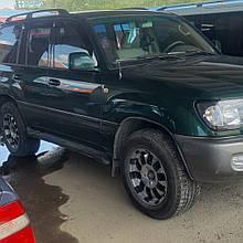 Дефлекторы окон (ветровики) клеющие / накладные  Toyota LC 100  1998-> 4D   (ANV)