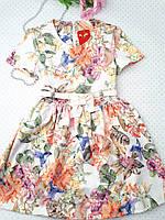 Очень красивое платье для девочки, с цветочным принтом  на 122 см.