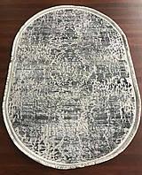 Серый овальный ковер, абстракция
