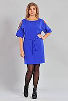 Модное женское платье красивого кроя с пояском