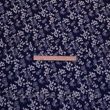 Французький трикотаж принт (на синьому тлі білі квіти)