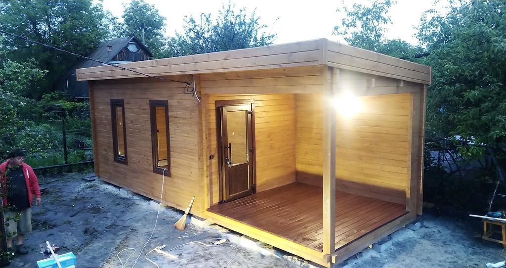 Дом деревянный из профилированного бруса 3х8 м, 3х3 м - открытая зона, 3х 5 м закрытая