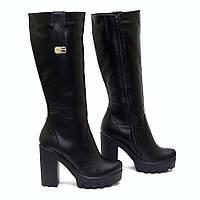 Зимние кожаные сапоги на высоком каблуке