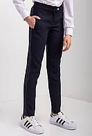Стильні шкільні брюки для дівчинки з кишенями і вилогами
