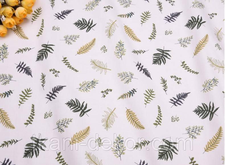 Сатин (бавовняна тканина) листочки різні на білому